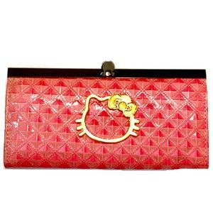 Pink wallet phone case with Hello Kitty emblem